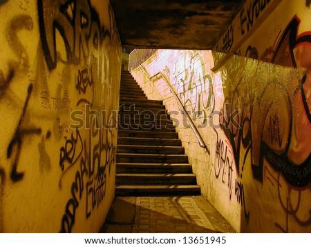 Pedestrian subway underpass with graffiti - stock photo