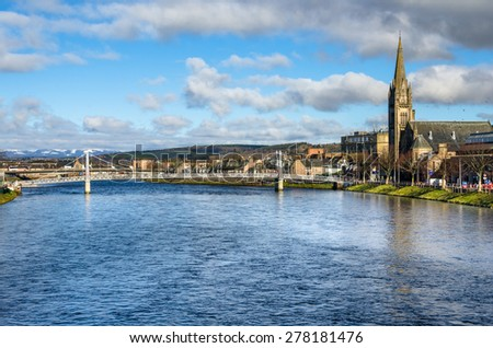 Pedestrian Suspension Bridge over the River Ness on a Cloudy Winter Morning. Inverness, Scotland - stock photo