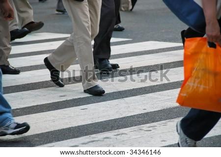 pedestrian traffic in crosswalk people - stock photo