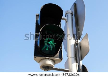 Pedestrian traffic lights with original green lovers signal, Vienna, Austria - stock photo