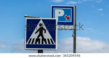 Pedestrian transit traffic  and parking sign  over the sky