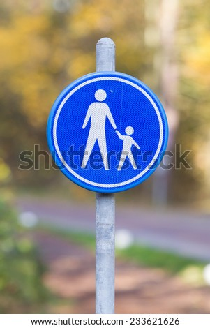 Pedestrian with children on road sign, the Netherlands - stock photo
