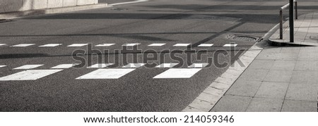 Pedestrian zebra traffic walk way in the city - stock photo