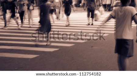 Pedestrians in modern city street - stock photo