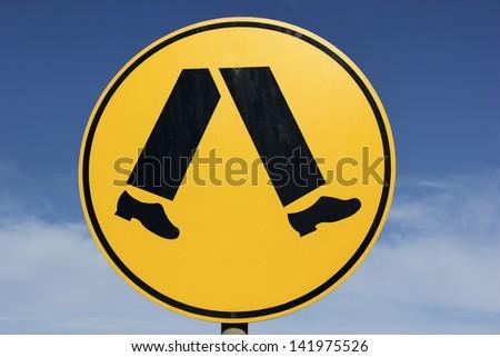 Pedestrians - round yellow sign seen in Australia - stock photo