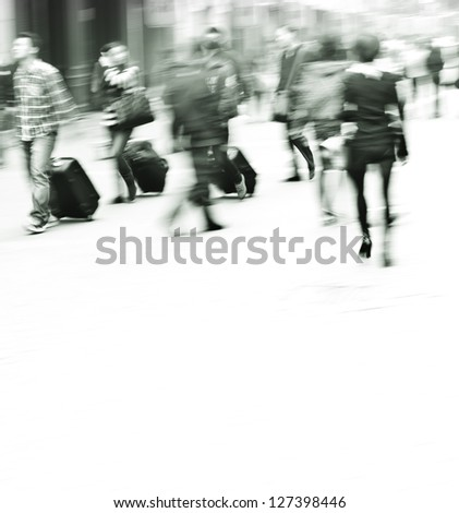 pedestrians walking in the streets in the modern city?black and white - stock photo