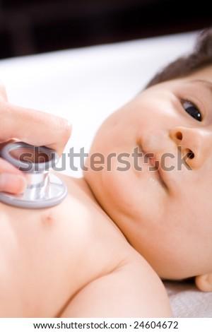 pediatrician checking cute baby boy - stock photo