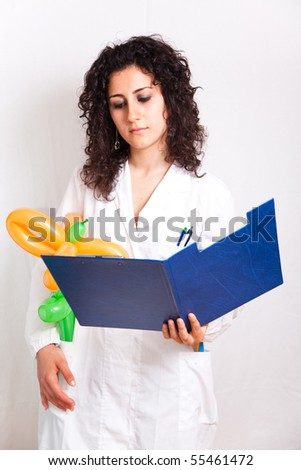 pediatrician female doctor with some toys - stock photo