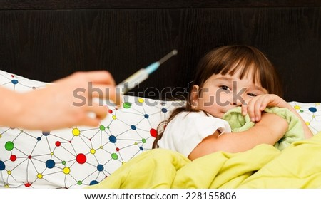 Pediatrician in hard situation - little patient being afraid of injection. - stock photo