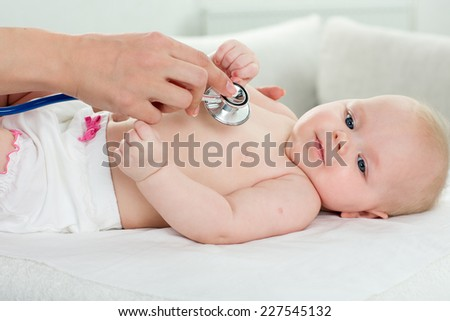 pediatrician inspection of little baby - stock photo