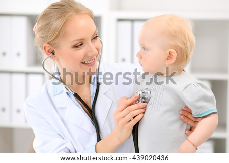 Pediatrician is taking care of baby in hospital. Little girl is being examine by doctor with stethoscope. Health care, insurance and help concept. - stock photo