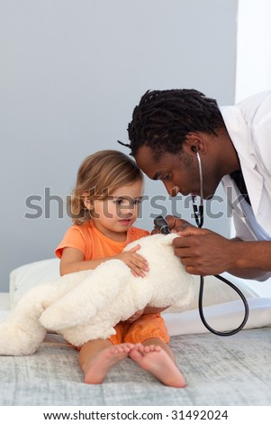 Pediatrician talking to a little girl in a hospital - stock photo