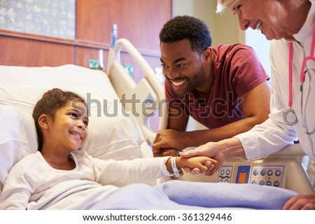 Pediatrician Visiting Father And Child In Hospital Bed - stock photo