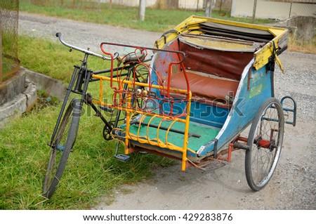 pedicab as indonesia traditional transportation - stock photo