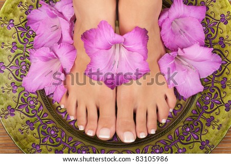 Pedicure and manicure spa with beautiful flowers - stock photo