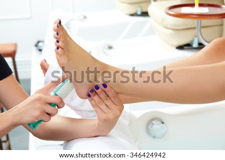 Pedicure dead skin remover foot rasp woman in nail salon - stock photo
