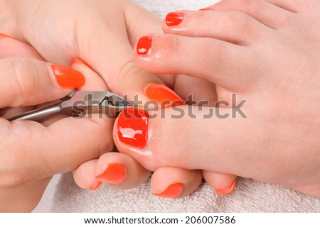 pedicure process macro closeup - stock photo