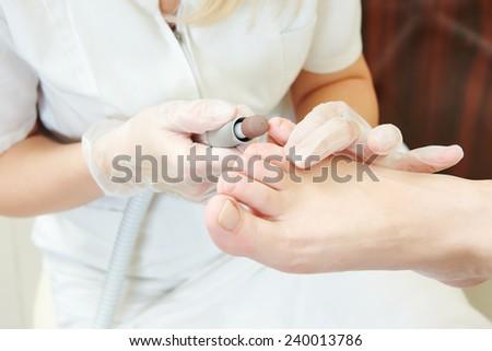 Pedicure technique. Sole treatment during foot care in beauty salon - stock photo