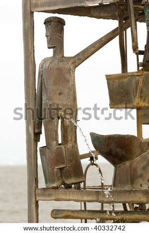 peeing tin man fountain in southwold, suffolk, UK - stock photo