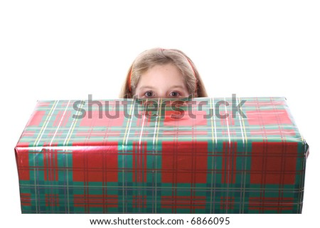 Peeking over a present - stock photo