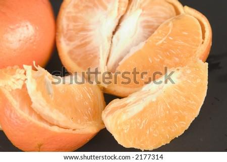 Peeled fresh tangerine fruit  (Shallow DOF) - stock photo