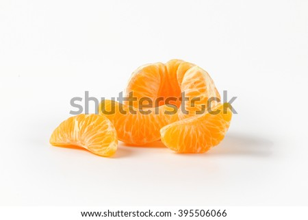 peeled ripe tangerine on white background