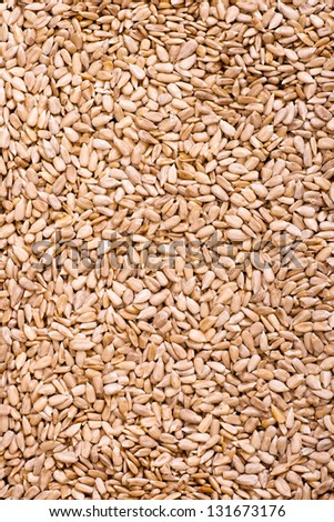 Peeled sunflower seeds background - stock photo