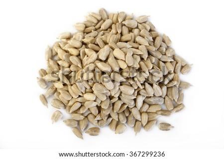 peeled sunflower seeds on white background - stock photo