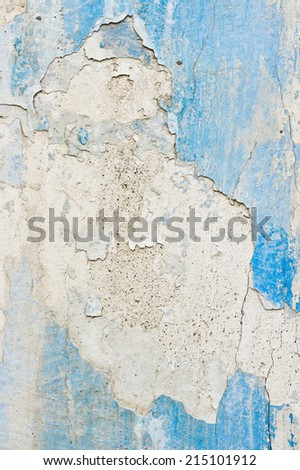 Peeling blue paint on a white wall - stock photo