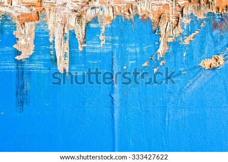 Peeling blue paint on an old piece of wood - stock photo