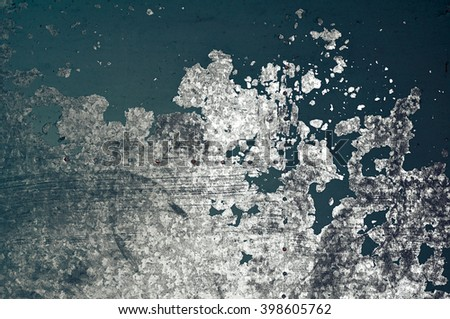 Peeling dark blue paint on a rusty textured metal surface - urban industrial decay background.  - stock photo