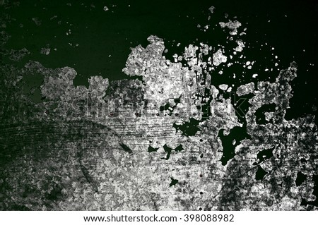Peeling dark green paint on a rusty textured metal surface - urban industrial decay background.  - stock photo