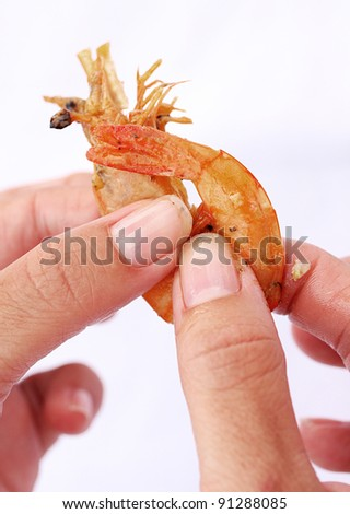 Peeling prawn - stock photo