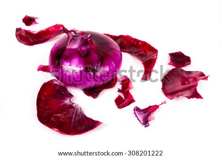 peeling red onion on white background