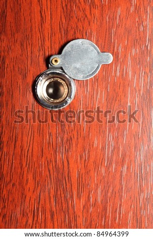 Peephole on wooden door - judas hole spyhole