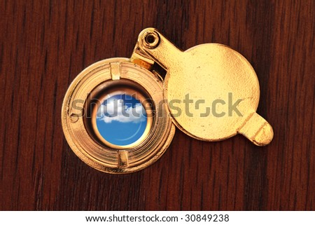 Peephole to the better world - stock photo