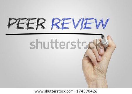 Peer review written on a white board - stock photo