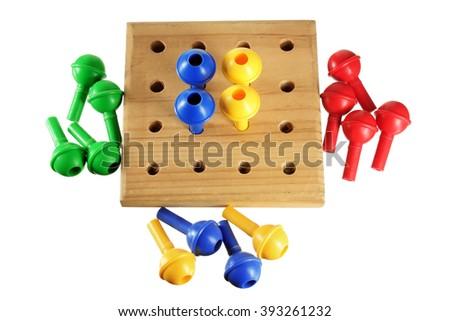 Peg Board Game on White Background - stock photo