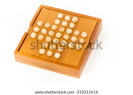 Peg solitaire wooden puzzle, isolated image. composite wooden figures for the development of logical thinking.  - stock photo
