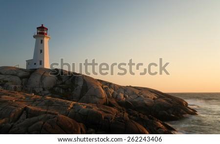 Peggy Cove Lighthouse at Sunset, Nova Scotia, Canada - stock photo