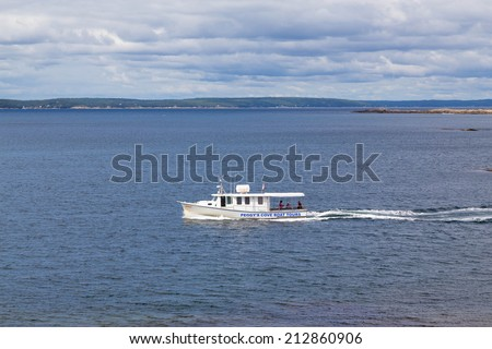PEGGY'S COVE, CANADA - 23RD AUGUST 2014: A Peggy's Cove Boat Tour boat in the water during the day. Passengers can be seen on the boat.