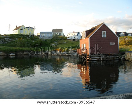 Peggy's Cove, Nova Scotia bathed in late afternoon light - stock photo