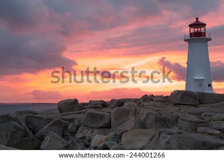 Peggys Point Lighthouse at sunset, Nova Scotia - stock photo