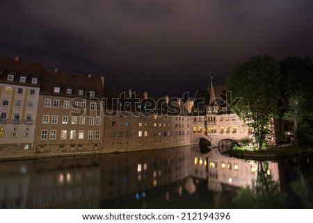 pegnitz river in nuernberg germany at night - stock photo