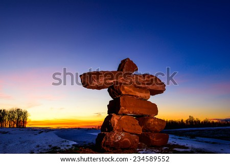 PEI Sandstone Inukshuk at sunset - stock photo