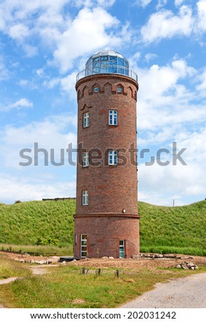 Peilturm at Kap Arkona, Island of Ruegen, Germany, green field - stock photo