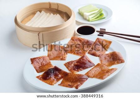 Peking duck set on the white tablecloth, one of famous Chinese food - stock photo