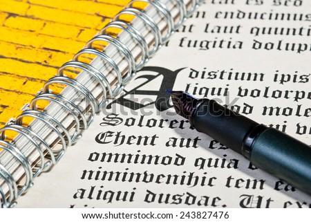 Pen and ancient gothic text. Dummy text Lorem ipsum - stock photo
