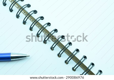 Pen and Blank Bond Papers on Top of White Table - stock photo