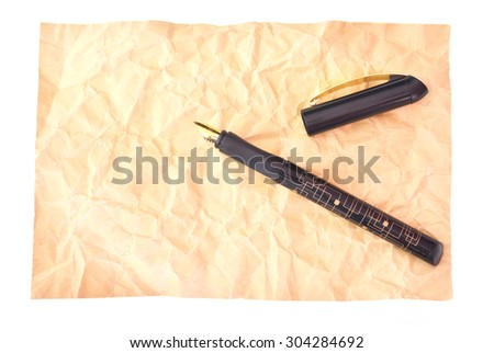 Pen and brown paper isolated - stock photo